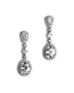 Two generous cubic zirconia - one oval cut and one hand cut in the tapered baguette style - are surrounded by tiny CZ stones.