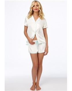 Easygoing comfort. The LUCIOUS LITE cami short set by Betsey is breezy and cute. The button up top features buttons down the center, while the shorts feature an elastic waistband with a string to adjust for comfort.