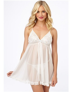 Diaphanous chiffon forms a floaty camisole and cheeky matching tap shorts, both charmed by sheer lace.