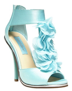Engage in an enchanted evening!  The BLOOM sandal by Betsey Johnson boasts flowers of chiffon and a sky-blue sole for a love-struck look.