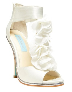 """Engage in an enchanted evening!  The BLOOM sandal by Betsey Johnson boasts flowers of chiffon and a sky-blue sole for a love-struck look.        •  Satin upper material       •  Synthetic sole       •  Chiffon embellished t-strap design       •  Zip entry at heel       •  Peep toe       •  4.5"""" covered stiletto heel"""