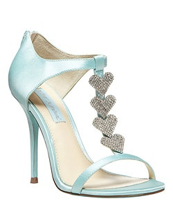 The FAVOR sandal by Betsey Johnson boasts hearts of pure crystal and a sky-blue sole for a love-struck look.      •  Satin upper/synthetic lining and sole