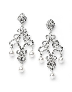 These drop earrings are made of sparkling Austrian Crystals and lustrous faux pearls.