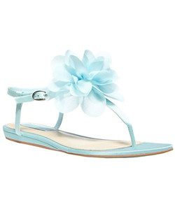 "Floaty petals compose a lovely bloom on a pretty satin thong sandal set on a signature ""something blue"" sole.