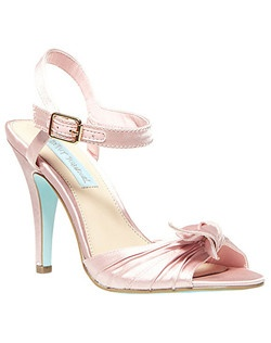 "Twinkly rhinestones accent the buckle on a gathered-satin sandal perched on a signature ""something blue"" sole.