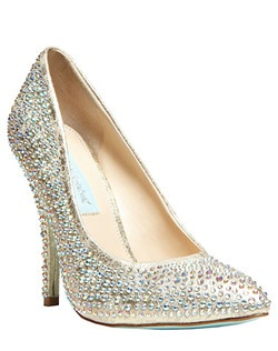 Like a dream come true. The SHINE evening pumps by Something Blue by Betsey Johnson are crafted in a brilliant, sparkling crystal fabric and feature a tall covered heel. 