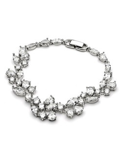 This Delicate CZ Bracelet is a formal accessory encrusted with clusters of dazzling Cubic Zirconia stones