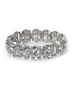 It is a stretch-style bracelet loaded with rows of multi-sized, hand-cut Genuine Austrian Rhinestones along sterling silver plate.