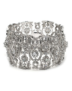 This bracelet features a delicate art deco style pattern of oval, teardrop, round, and pavé cubic zirconia.