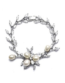 This silver plated wedding bracelet has the perfect balance of gorgeous pearls and Cubic Zirconia stones in a floral vine detailing.