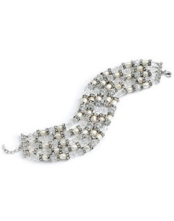 This bracelet is made with GENUINE SWAROVSKI CRYSTALS, lustrous fresh water pearls and accented with rhodium plated rhinestone rondells.