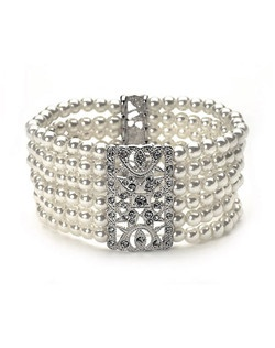 Pearl and Antique Silver Bracelet is a vintage-inspired bracelet featuring rectangular rhodium ornamentation with a beautifully intricate design encrusted with rhinestones.