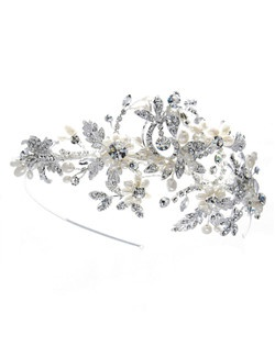 The Dramatic Sprays Headband will add stunning beauty with dramatic sprays of freshwater pearl flowers and rhinestone encrusted leavesfor the ultimate in floral beauty.