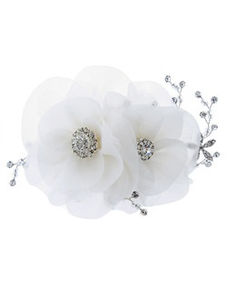 Hair flower features two soft ivory petal flowers accented with rhinestone centers and floral sprays.