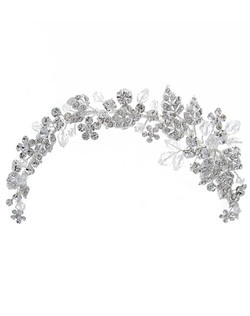 The Floral Accented Hair Vines Headpiece is the perfect accessory for a dramatic look on your most special day. This unique headpiece features a floral motif of sparkling rhinestones and Swarovski crystals hand-wired on a flexible vine.