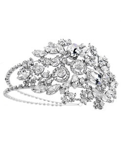 Stunning multi cut rhinestones cascade up to a remarkable side accented design.