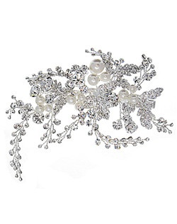 The Rhinestone Vines Hair Clip will add brilliance and luster to any hairstyle. This unique hair clip features rhinestone encrusted leaves, light ivory faux pearls and sprays of brilliant vines that can be positioned to suit your own style.
