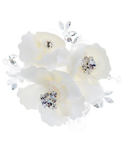 Comb features a symphony of soft open bloom petals, layered sheer accents, and rhinestone and Swarovski crystals.
