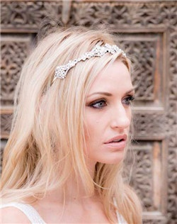 Stunning Swarovski crystal headband set on silver filigree accented with Swarovski pearl. Can be worn as a headband or tilted up to wear tiara style. Rhodium plate.