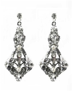 These sparkling Swarovski crystal earrings will add elements of Hollywood glamour and elegance to your bridal or formal look. Brilliant Swarovski crystals adorn silver filigree with small Swarovski pearl accents. The detail of the various crystal shapes and baguettes is beautiful!