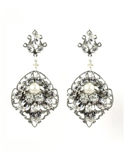 Classic and elegant! These double sided earrings are as beautiful from the back as they are from the front. Silver leaf shaped filigree, Swarovski marquis shaped crystals, Swarovski glass pearls, and crystal chain.