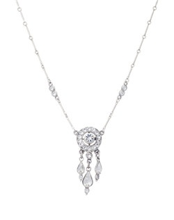 The teardrop hanging crystal details create beautiful movement in this necklace, and the delicate chain has crystal embellishments to give a finished look. This necklace is perfect for the boho chic or beach bridal ensemble –non-traditional but still movement and sparkle.