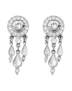 The teardrop hanging crystal detail creates beautiful movement in these earrings, which will work well with either a soft up-do or long and flowing hairstyle. Perfect for the boho chic or beach bridal ensemble -nontraditional but still movement and sparkle.