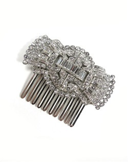 Ben-Amun's Époque Hair comb, inspired by jazz age elegance, is best suited for wedding day wear or as a romantic touch to an everyday look. Swarovski crystals lined in enchanting patterns act as striking hair ornaments perfect for anchoring a chignon or creating a timeless look tucked into tresses.