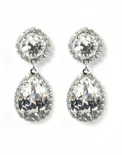 Another version of the pear shaped Swarovski chandelier by Ti Adoro! These pear drops have a cushion cut crystal post to give a little extra sparkle. Accented by a clear rhinestone bezel. Set in rhodium plate and hand soldered.