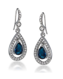 "The Bonnie teardrop earrings are a beautiful Sapphire tone crystal earring. The Center stone drop is encompassed with a halo of clear crystals. Earrings measure 1 1/4"" drop on a French wire. Available in Silver Tone."