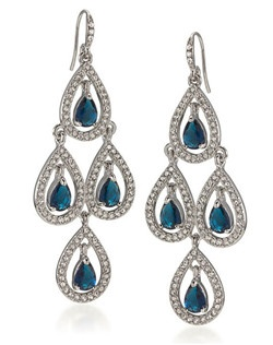 "The Marin Earrings are a gorgeous Sapphire Blue chandilier style earring. The Tiered design allows each gem to glitter in the light and moves nicely set on a french hook. The Blue and clear crystal accents create a beautiful contracting effect. The perfect Something Blue for any Bride. Earrings Measures 3 3/4"" long with 1"" width."