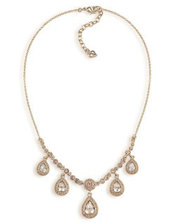 "The Kelly necklace in gold and topaz is like dazzling drops of glamour cascading at the neckline. The beautiful teardrop crystals instantly update your evening look with ladylike sparkle. Necklace measures 16-18"" with a lobster claw clasp closure. Available in gold tone with topaz stones."