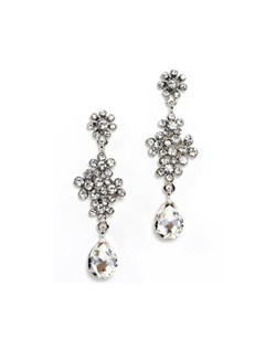 "Antique silver rhodium plating with Swarovski crystals stones are both romantic and modern. Clusters of stones are finished with a pear shape drop. This earring measures 3"" long, and is .5"" wide."