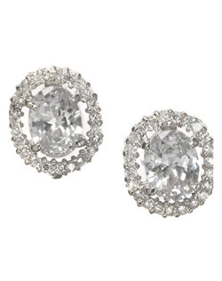 Oval shaped and prong set cubic zirconia stud with a tiny row of stones surrounding the earring. A beautiful classic earring with a ton of sparkle.
