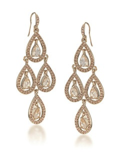 "The Sophia Topaz chandelier earrings are a beautiful work of art. The tiered design allows for movement with these glittering rhinestones. The Topaz stones are encompassed with clear crystal accents. The Soft Gold tone is gorgeous with any attire. Earrings measure 3 3/4"" in length with a 1"" width on a French hook."