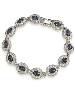 "The Brittany is a stunning Sapphire Blue crystal bracelet. The Blue oval stones are encompassed with small clear rhinestones for an elegant look. The perfect something blue for any Bride as well as her Bridesmaids. Bracelet measures 7"" with a fold over clasp closure."