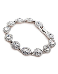 "The Lucy bracelet is a clear crystal bracelet with stunning stone accents. The classic styling of this bracelet is stately and traditional. The perfect match for many of our other bridal accessories. Bracelet measures 7"" with a fold over clasp closure."