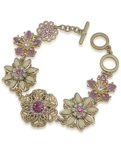 "The Tea Cup Bracelet is a vintage inspired floral flex bracelet with pastel stones. Sure to become the highlight of your favorite daytime or evening look. It was made perfectly with just the right amount of intricate detail and pastel color. Bracelet measures about 8"" with a toggle closure available in gold tone. Perfect to finish off a bridesmaid look."