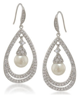 "The Looking Glass pearl and crystal earrings are absolutely fitting for a bride to be. Capture your loved ones attention on your special day in these gypsy hoops pierced earrings and a simple smile. Earrings measure 1 3/4"" long with a width of 1"". The pearl center measures 8mm with a french hook. Available in Silver tone."