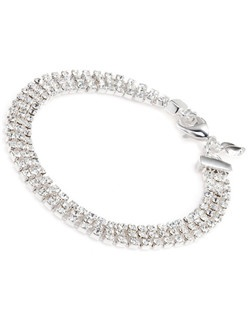 "The Shelly Bracelet is Red Carpet ready. The three row crystal design catches the light and glitters away with every move you make. Wear one or pile them on for a dramatic look. Bracelet measures 7"" with a lobster claw clasp closure. Available in silver tone with clear stones."