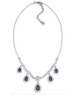 "The Pheobe is a beautiful Blue crystal Teardrop necklace that cascades along the neckline. Blue and clear crystals cascade beautifully into a 16-18"" drop length. The Metal is a silver tone with a lobster claw closure."