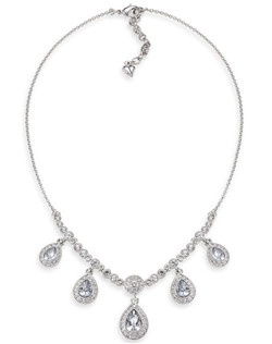 "Beautiful crystal teardrop necklace that cascades along the neckline. The teardrops are encompassed with smaller rhinestones for a stately look. Necklace measures 16-18"" and is adjustable with lobster clasp closure. Available in Silver tone."