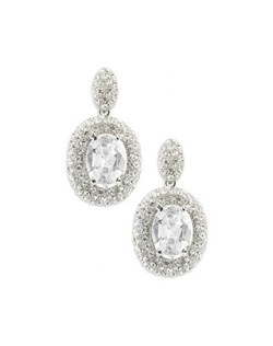 """Crystals are set tightly together, pave' style to give these earrings great texture and detail. Each is finished with a single oval crystal for extra impact. This glamorous earring measures just under 2""""."""