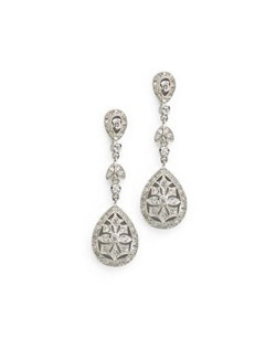 "Wear these delicate pave' set cubic zirconia earrings when you want a fine-jewelry, vintage look. Each pierced earring measures 1.5"" long."