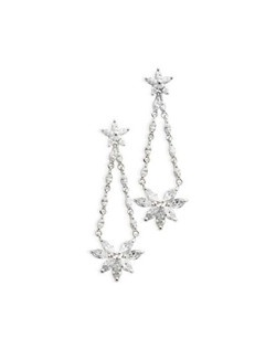 Lavishly long at 2 inches, these cubic zirconia earrings still have a delicate look to them. Marquis shaped cubic zirconia are grouped in a floral pattern and set in silver.