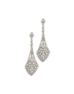 """Antique charm meets modern design in these radiant cubic zirconia chandelier earrings in your choice of silver or gold. Round cut stones are set within an intricate base, designed to sway and move to catch the light. At 2 5/8"""" long these earrings make a gorgeous statement."""