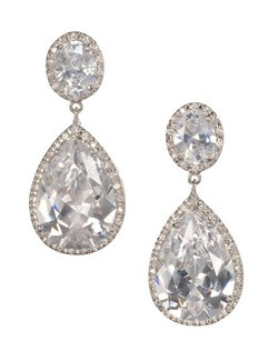 "A gorgeous and dramatic cubic zirconia drop style earring. Oval stone at the top encrusted with tiny stones, leading to the pear shaped pave' encrusted dangle. Length 1.5""  Width .65"""