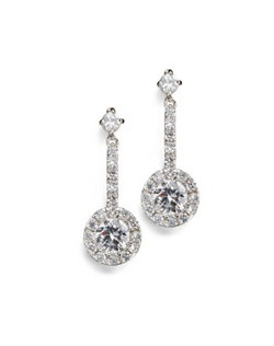 "These dainty classic earrings have understated style with plenty of sparkle, expertly cut and hand set cubic zirconia. Each pierced earring measures 1"" long."