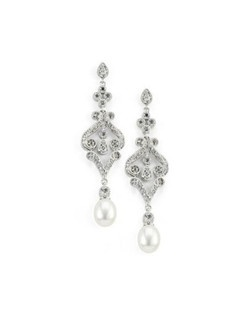 "A filigree design and delicate freshwater pearls gives these cubic zirconia earrings a vintage look. Each pierced earring measures approximately 2""."