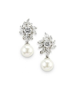 "Cubic zirconia sparkle beautifully in these garden-inspired earrings. Each is set with a pearl drop so they dangle just a bit. Earrings measure just over 1""."